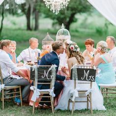 Jazz up the bride's and groom's seats to stand out from the rest of the table with some sweet �Mr. and Mrs.� signage.