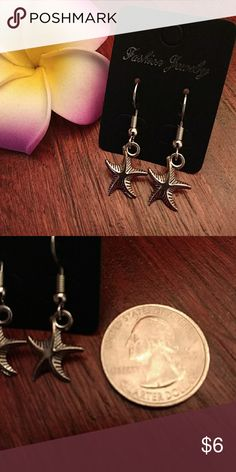 Starfish earrings NWT. Silver tone earrings with starfish charms. Great accessory for your next tropical vacation. Be sure to check out my other earrings! 5% discount on bundles Jewelry Earrings