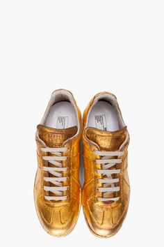 These metallic gold Maison Martin Margiela sneakers are EVERYTHING