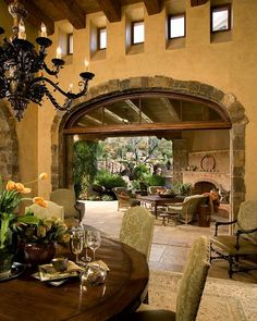 Hacienda covered courtyard with outdoor garden, attached to dining room with closable doors.