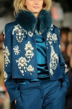 Love the head to toe Teal not sure about all the pearl applique