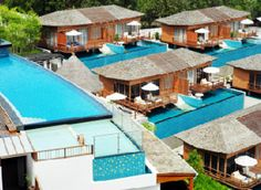 KC Resort - Koh Samui, Thailand  All rooms are built over infinity-edge pools with a glass section of floor built into each room.