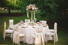 Aamodt's Apple Farm Wedding Photo Shoot Stillwater, MN party rental. Taryn Christine Photography. -- Sparkly Opulence sheer overlay tablecloth over our blush pink satin linen. White Washed chiavari chairs with a champagne/cashmere satin chair sash and diamond buckle accent. Gold antique venetian floral riser with a lush floral centerpiece. --