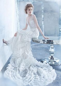 Find this Ivory beaded and embroidered Art Deco inspired slip gown by Lazaro, at Gigi's Bridal in Mequon!