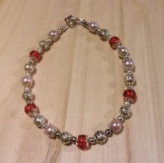 Red,pink and silver clasped bracelet  £3.00
