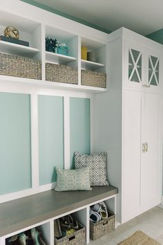 beach style mudroom with turquoise and white colours