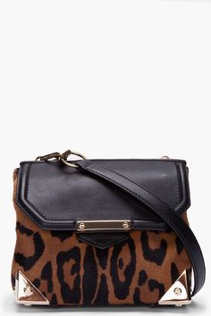 Alexander Wang Leopard Calf_hair Marion Bag -  Alexander Wang Leopard Calf_hair Marion Bag Alexander Wang Leopard print calf_hair bag in black and light brown. Antique gold tone hardware and black textured leather trimmings throughout. Slide clasp closure at front flap. Metal cornices at base. Removable adjustable shoulder strap. Lined. Two...