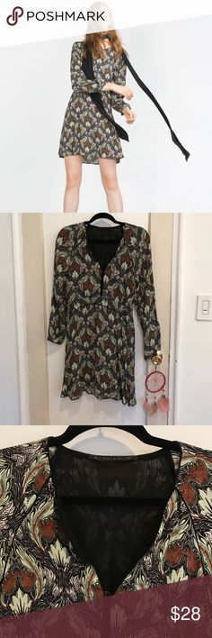 New Zara Multi Printed Dress. Size large New never worn Zara Multi Printed Dress with beautiful ostrich feather style print in nice greens and browns design. Long sleeve and button up or down option in neckline. Size large zipper on side. Very cute with brown boots! Selling cheap!! Too late to return accepting best offers! Zara Dresses Mini
