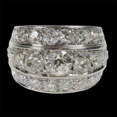 René Boivin, Paris 1935 - 3 row diamond ring set with a central tapered row of old European brilliants inbetween two rows of smaller diamonds mounted in platinum