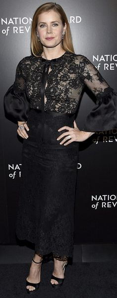 Who made  Amy Adams' black platform sandals, jewelry, clutch handbag, and black lace dress?