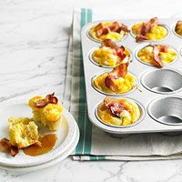Bacon-and-Egg Muffins...Made these as a trial this morning from my new BHG mag.  Saw it & thought preschool snack & Easter morning. Will definitely put this on the go to Brunch or entertaining list...super easy and delish for everyone!  We love maple flavor so I used Maple flavor bacon and brown sugar instead of white....Delish!