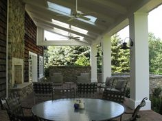 Covered Porch with skylights, spa and outdoor fireplace.