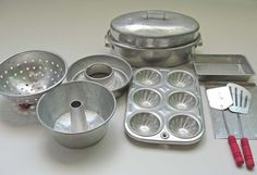 I had this set as I child. Wish I still had it! I remember getting to make real litttle cakes or cupcakes when Mom baked. Vintage Toy Bakeware Set 1950's.