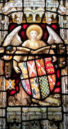 Heraldic glass in the Church of St. John the Baptist at Cardiff, Wales -- detail of 19th century window depicting angels supporting the armorial bearings of the historic Lords of Cardiff Castle