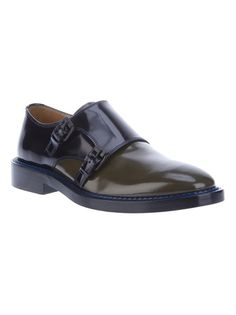 Forest green leather shoes from Kenzo featuring a round toe, a black panel to the middle with buckles to the side, a black panel to the back, a shiny finish, a blue stitched trim, a flat heel and a leather sole.
