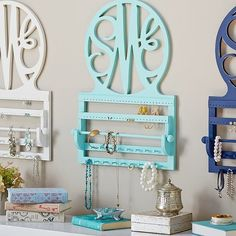 Script Monogram Wall Jewelry Storage: Jewelry lovers are always looking for a fun place to place their earrings. PB Teen's Script Monogram Wall Jewelry Storage ($149) has spaces for earrings, necklaces, bracelets, and more.