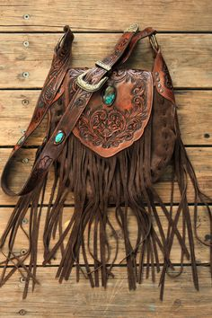 Western Floral Saddle Bag with high grade turquoise inlays. Brown suede and antique brown panels. Hand carved, tassels aplenty. One of our most most regal designs!