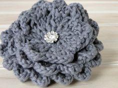 Knitted flower brooch.