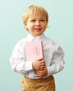 A ring box is easier for little hands to clasp than a slippery pillow. Make it yourself: http://www.marthastewartweddings.com/226624/ring-bearer-book-how?czone=inspiration/DIY/decorations=272429=230988=102896