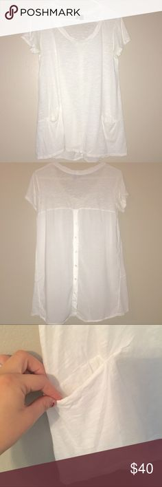Anthropologie white long tunic Extra long t-shirt from Anthropologie, brand: Left of Center | Buttons down back | Pockets in each side of front | Barely worn, no flaws Anthropologie Tops Tees - Short Sleeve