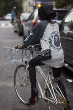 Love it cycling to the shops with a Chanel handbag and skyscraper heels x
