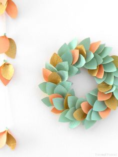 Christmas is sneaking up on us at an alarming rate… time to get your craft on! I designed this paper wreath a few years ago and decided it was time for an update with pastels and gold. The wreath is easy to make with materials you already have around the house or in your craft …