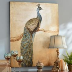 Peacock Perch Canvas Art Print | Kirklands - I have this picture and love it.  I paired it with wrought iron black sconces on each side and found some teal blue votives to put in the sconces.  It really makes the room!