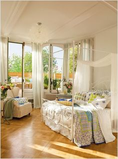 A Wrought Iron Bed in White is The Most Elegant and Subtle Way to Include Ornate Designs