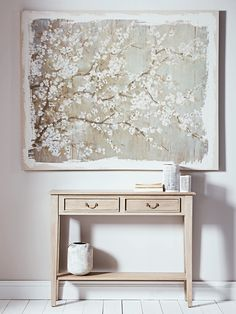 Introduce a stunning new centrepiece to your living space with our large Blossom Canvas. This high quality painted canvas features an abstract blossom image in soft tones of blue, green, white and taupe with a rustic painted edge. Each canvas includes two hooks on reverse, making it easy to display this larger-than-life canvas in your living space or bedroom. This product is not available for Next Day Delivery in the UK and due to the size and weight of this item it is not currently…