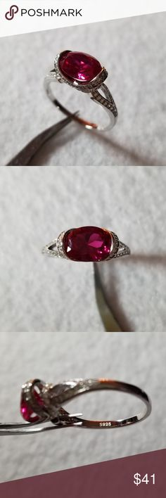 Horizontal Lab Created Ruby I'm seeing more and more rings with an oval stone set sideways. This ruby has an amazing color and fire, it's beautiful. It also doesn't snag on anything because there are no prongs. There's open work on the sides and pave simulated diamonds all over the band. Set in solid sterling silver, see pics for details and 925 stamp. Jewelry Rings