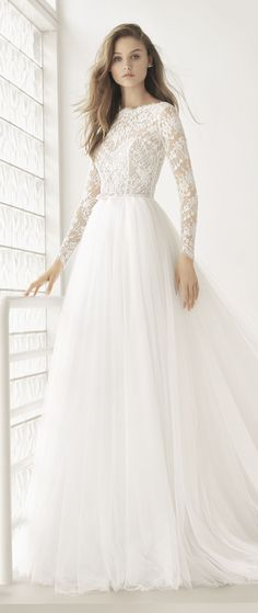 I don't think I'd have long sleeves like this unless I got married in winter, but this dress is beautiful