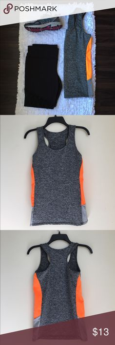 Always Workout Tank-Top NWOT Workout tank top. The fabric is light, stretchy, and, also breathable. It's mainly grey with orange on the side along with a bit of lighter grey. *92% Polyester and 8% Spandex *L/XL Tops Tank Tops