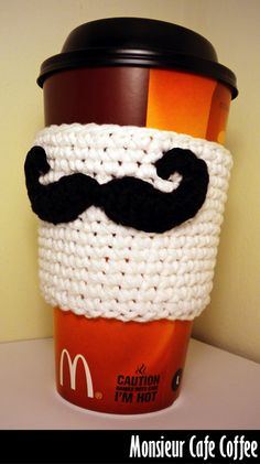 mustache coffee cozy...okay so the girls can't crochet but they could do felt with precut designs that they add...could make ahead with button closure...make and take