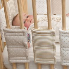 Cot Bumpers - Beige  - £30.00 Liam needs this lol hes all the time getting his arms or legs stuck in the bars