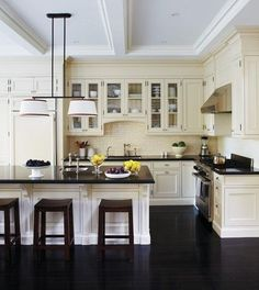 ivory kitchen cabinets with dark floors