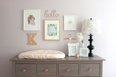 Kenley's Soft and Feminine Nursery with gold details l Wall collection above dresser