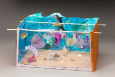 Aquarium Acrobats lesson plan - I would get a large box and the students would just make one big aquarium.  I'd prep some index cards with the names of things belonging in an aquarium and a picture of it.  Each student would pick a card and then create that thing for the class aquarium.