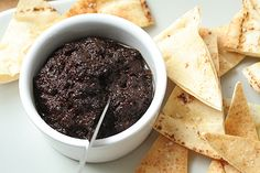Raise a pastis to French independence! Dilute the anise liqueur with cold water, then add ice - ice first will crystallize the pastis! The perfect accompaniment to a chilly glass of pastis? This oily, inky, olive tapenade from David Lebovitz!