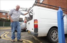 Livid: Window cleaner Andrew Wilson was given a £70 parking fine because his van was overhanging yellow lines by one inch.
