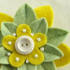 Spring Green and Yellow Felt Flower Pin with White Vintage Button - Mother's Day.  via Etsy.