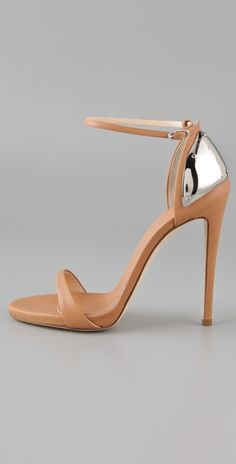Nude ankle straps w/ a silver heel accent. Shoes that scream we can't wait for Spring.