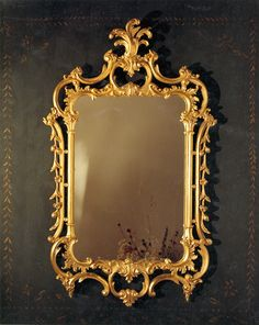 A fine exuberant Chippendale, this mirror is crested by the ever favored acanthus leaf. Hand gilded with antique gold leaf finish fitted with a beveled mirror.