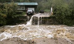 The National Guard is evacuating a Colorado town cut off by raging floodwaters, while forecasters called for some let-up in record rains tha...