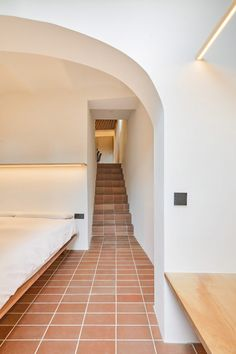 Throughout the project Mas-aqui chose a simple, natural palette of concrete, red ceramic tiles, white walls and plain wood for Yurikago House. Concrete Retaining Walls, Concrete Fireplace, Exposed Concrete, Gaudi, Barcelona Apartment, Wooden Stairs, Ground Floor Plan, Modern Staircase, Level Homes