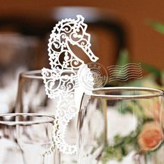 Pack of laser cut sea horse table name cards for por Bielyse