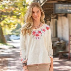"""SCARLET BEGONIAS TOP--Beguiling embroidery sweeps down the yoke, hem and sleeve of our forgiving, relaxed-fit, drop shoulder knit top. V-neck with exposed back seam. Cotton. Machine wash. Imported. Exclusive. Sizes XS (2), S (4 to 6), M (8 to 10), L (12 to 14), XL (16). Approx. 25""""L."""