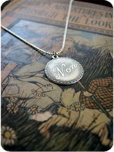 Vintage French Word 'Non' Necklace - $12