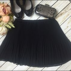 """✨NWOT✨ Victoria's Secret Black Pleated Mini Skirt This black flowing mini skirt from Victoria's Secret has mini pleats that lead to larger pleats creating a wondrous effect! This skirt can be worn year round depending how you dress it up! It's a perfect staple to have in your closet!!!⭐️Price Firm Unless Bundled⭐️   - Never worn - Back hidden zipper - Lined - In perfect condition.  - 16"""" at waist/hips laying flat; 16"""" long - 100% Polyester  ❌ Trades 💯 Authentic  ❌ PayPal 💞 Discounts on…"""