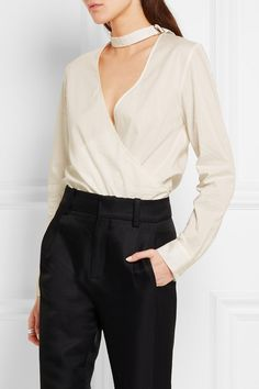 ONLINE EXCLUSIVE AT NET-A-PORTER.COM. Anja Rubik's capsule collection with Parisian label IRO references her own off-duty style. Cut from an airy cotton and silk-blend, this chic wrap-front blouse is detailed with a choker strap. Emulate the supermodel's look by teaming it with tailored pants and sky-high sandals.