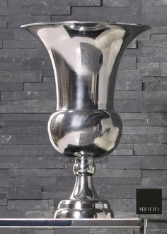 A big aluminium vase to put on a side table. Wouldn't it look amazing with ducat roses inside?  #vase #aluminium #accessories https://www.facebook.com/MiottoDesign